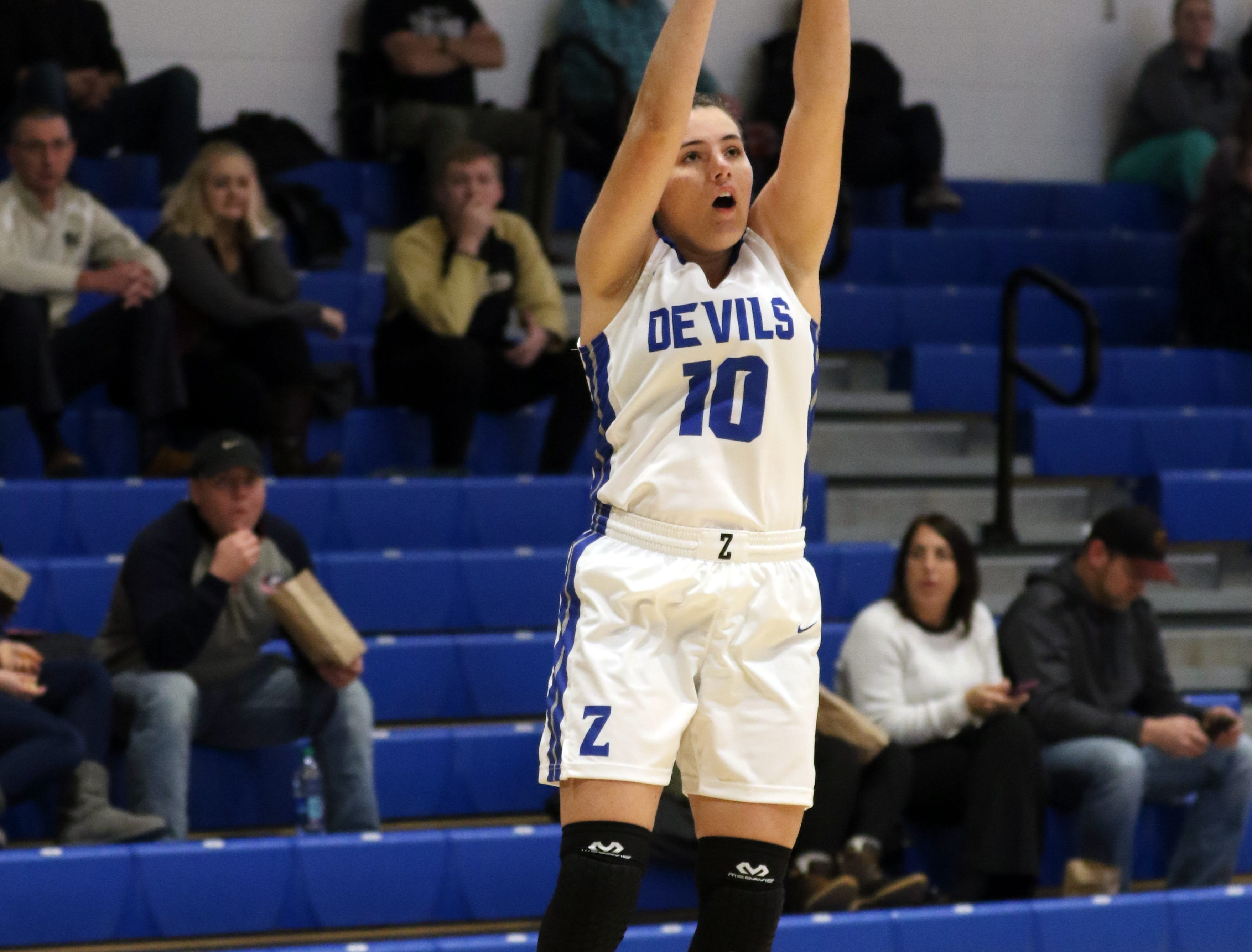 Zanesville's Aayla Mayle fires a shot against River View.
