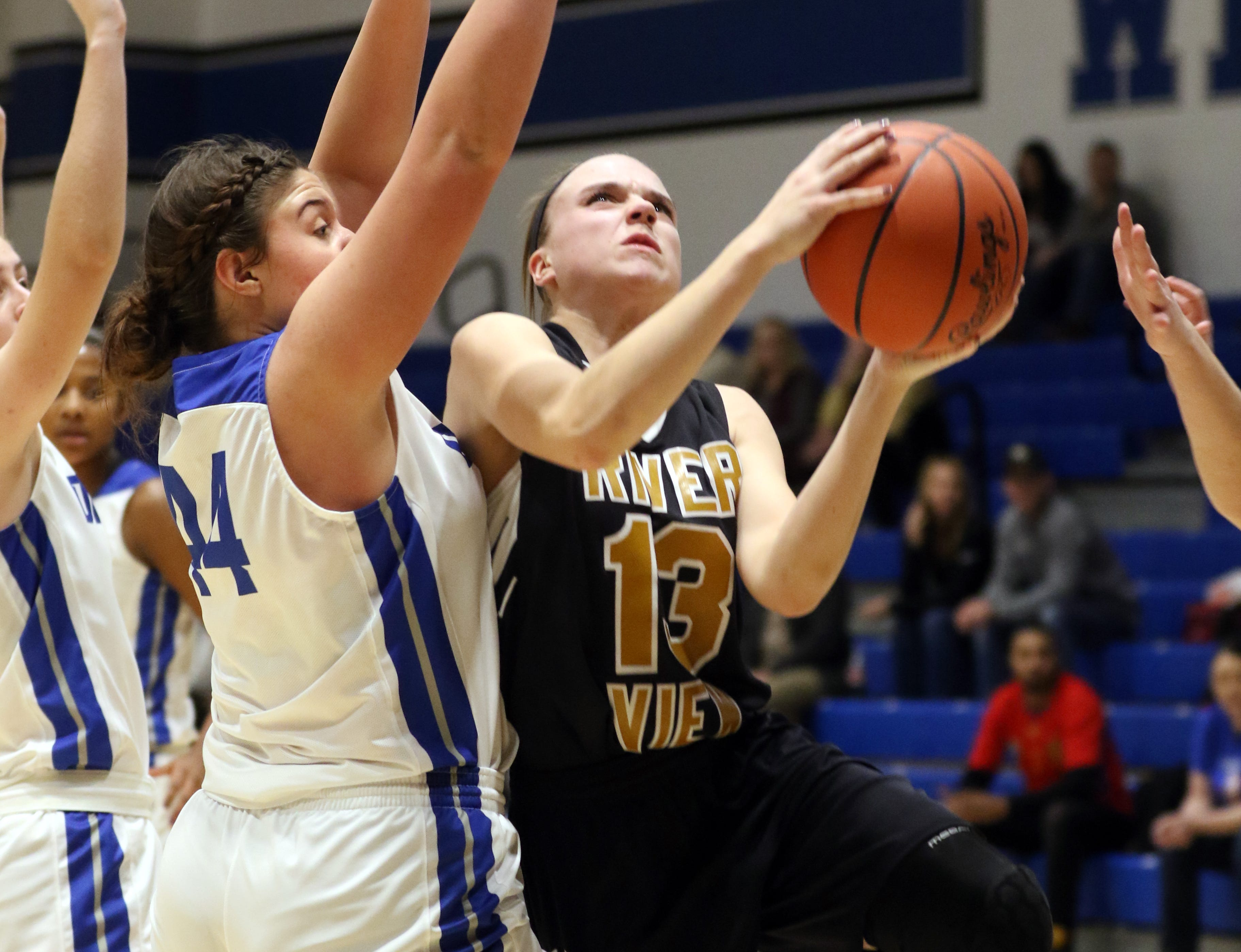River View's Kelsey Hartsock puts up a shot against Zanesville.