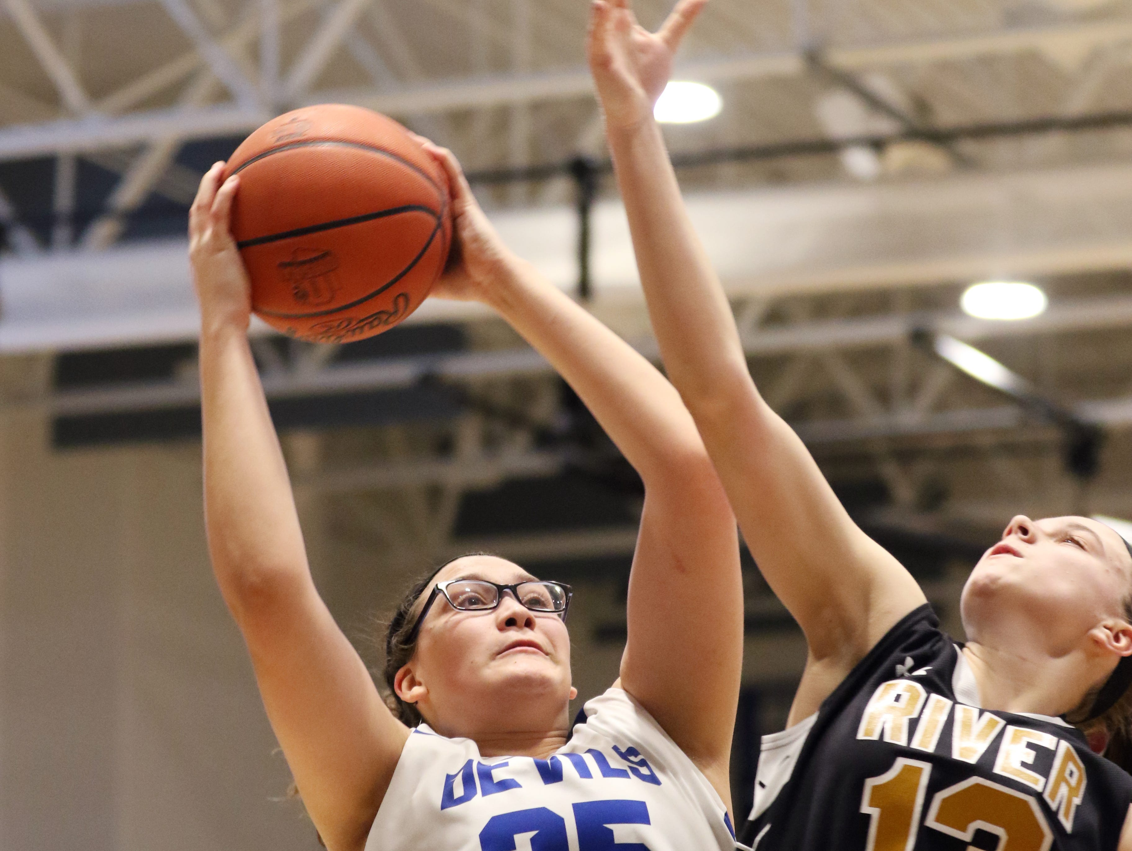 Zanesville's Alena Mayle and River View's Kelsey Hartsock go up for a rebound.