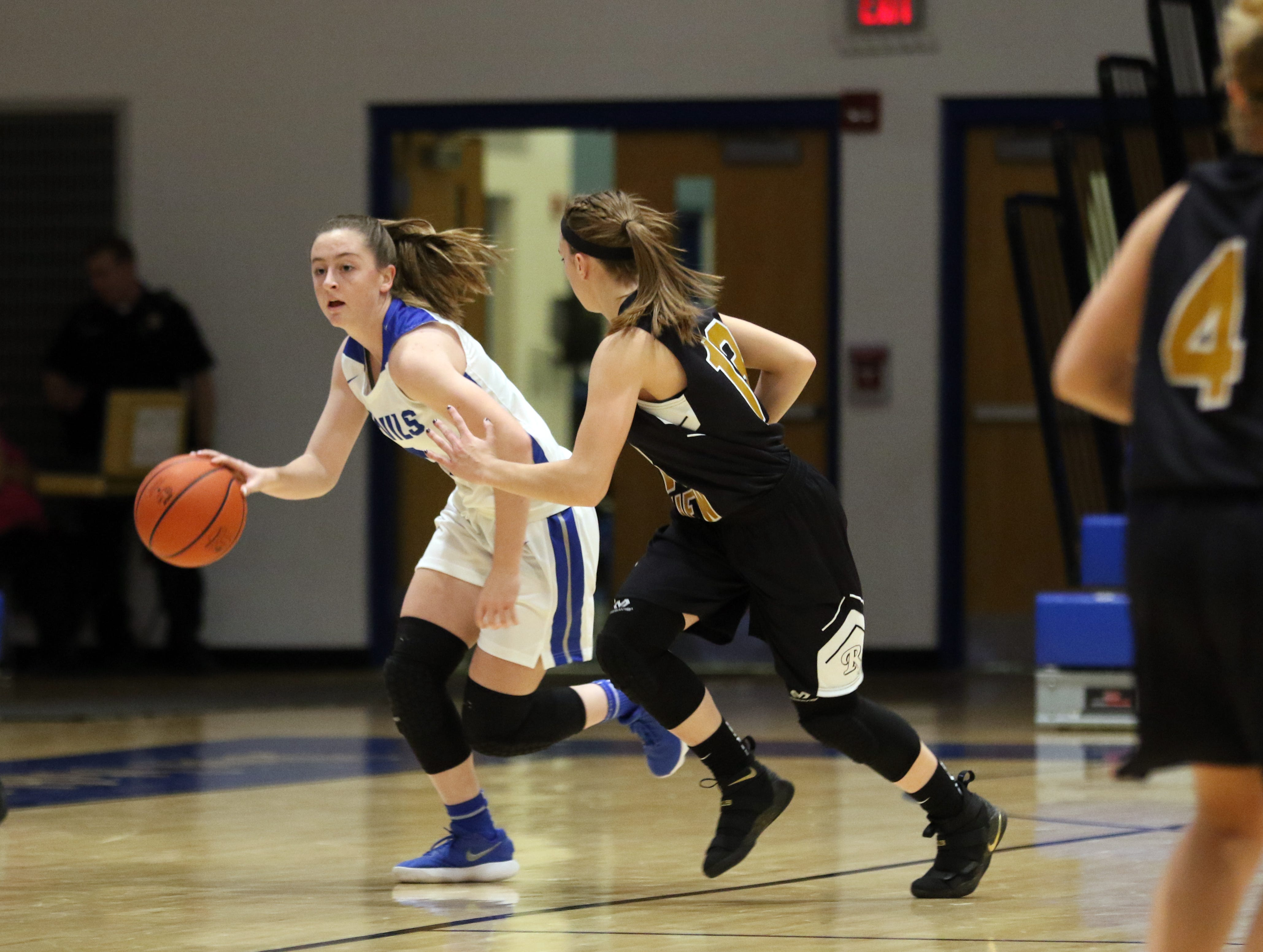 Zanesville's Madison Winland moves with the ball against River View.