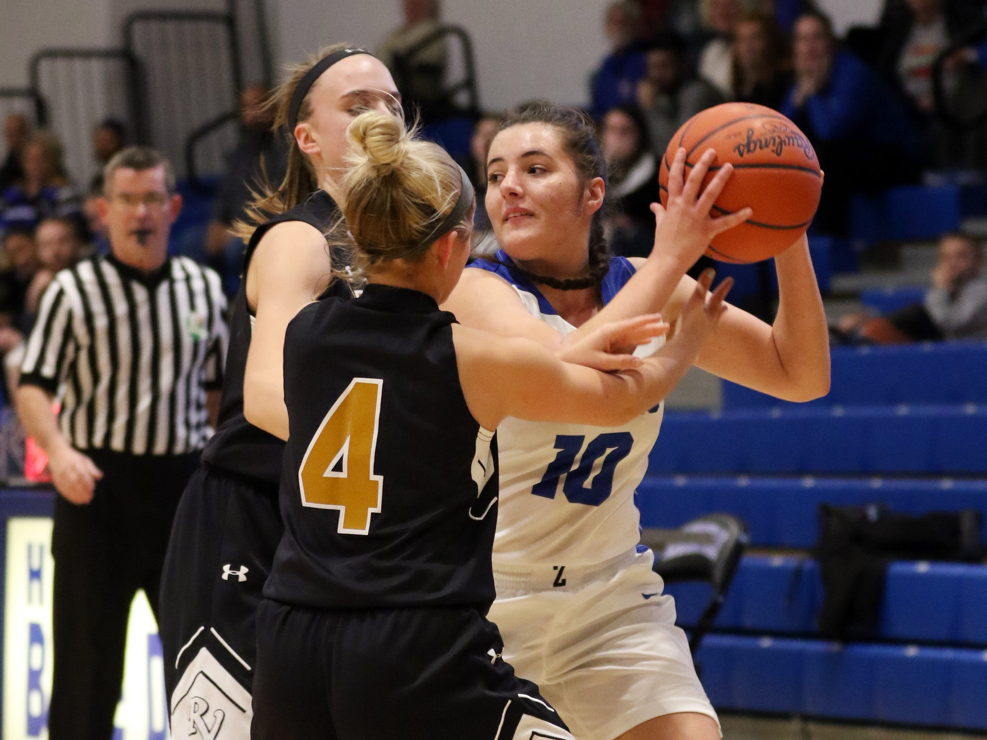 Zanesville's Aayla Mayle finds herself in defensive pressure from a pair of River View defenders, Lexi Fry (4) and Kelsey Hartsock.