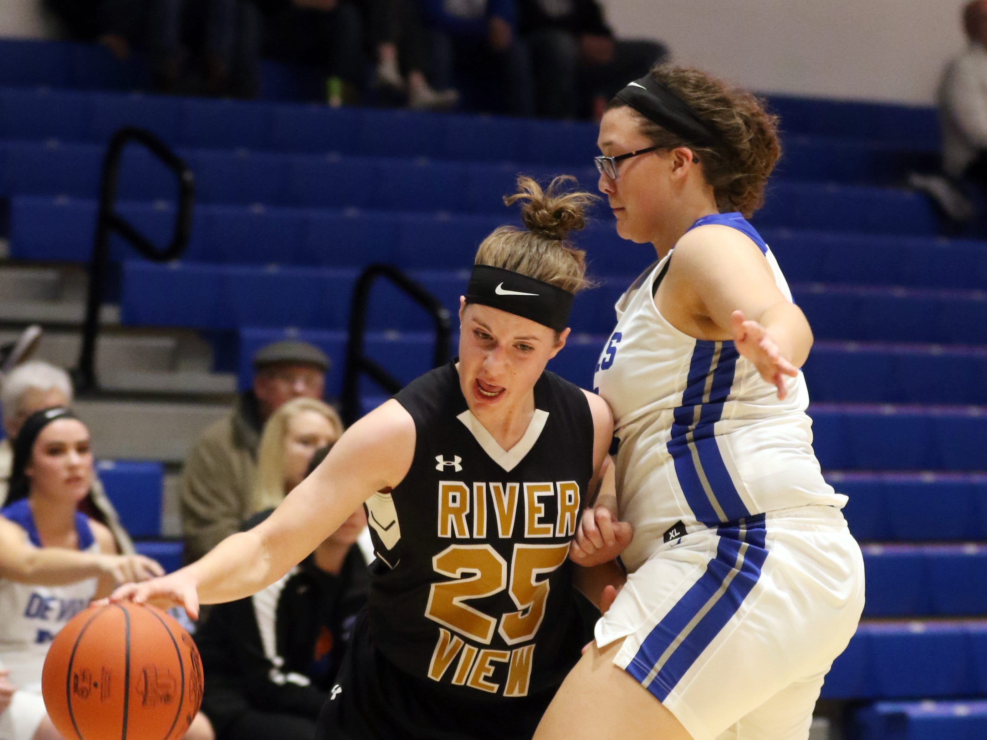 River View's Jessica Hartsock fights her way past a Zanesville defender.