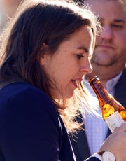 Colorado state Sen. Kerry Donovan, a Democrat who chairs the Colorado Senate's Agriculture, Natural Resources and Energy Committee, smells a bottle of The Hemperor HPA, a beer from New Belgium Brewing made with hemp seeds and stems. The beer smells like cannabis, although it contains no THC or CBD.