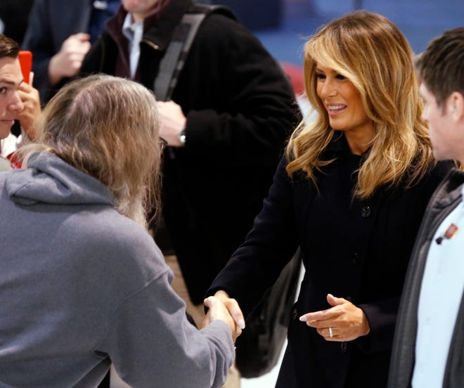 First Lady Melania Trump greets members of the crowd during a tour of Joint Base Langley in Hampton, Va., on Dec. 12, 2018.