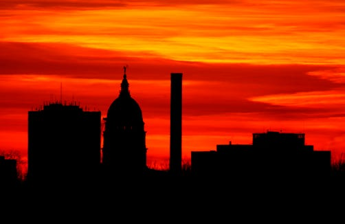 The sun sets behind the Kansas Statehouse in downtown Topeka, Kan., Monday, Dec. 21, 2009.