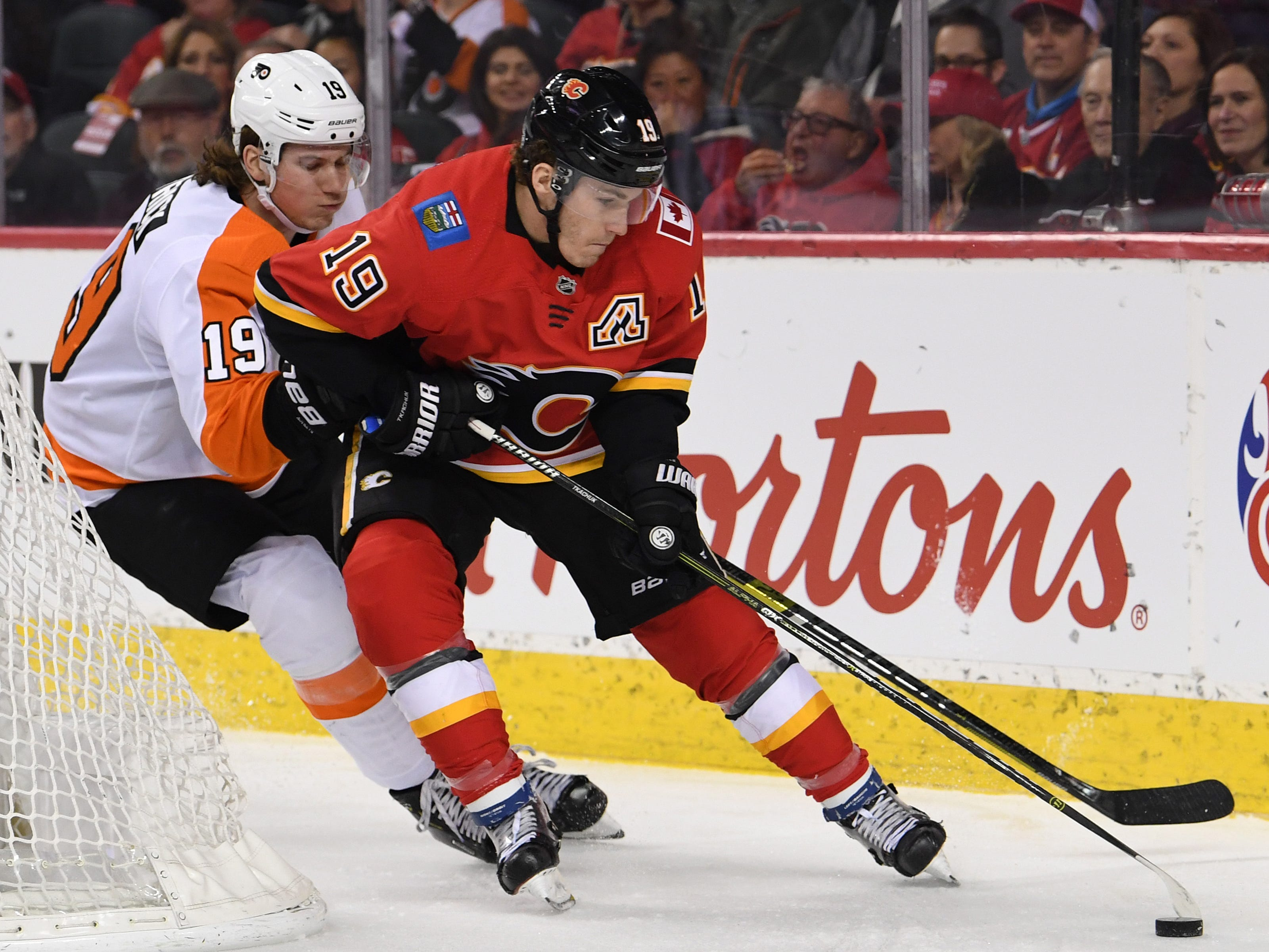 Dec. 12: Calgary Flames left wing Matthew Tkachuk battles for the puck with Philadelphia Flyers center Nolan Patrick during the first period at Scotiabank Saddledome. The Flames won the game in overtime, 6-5.