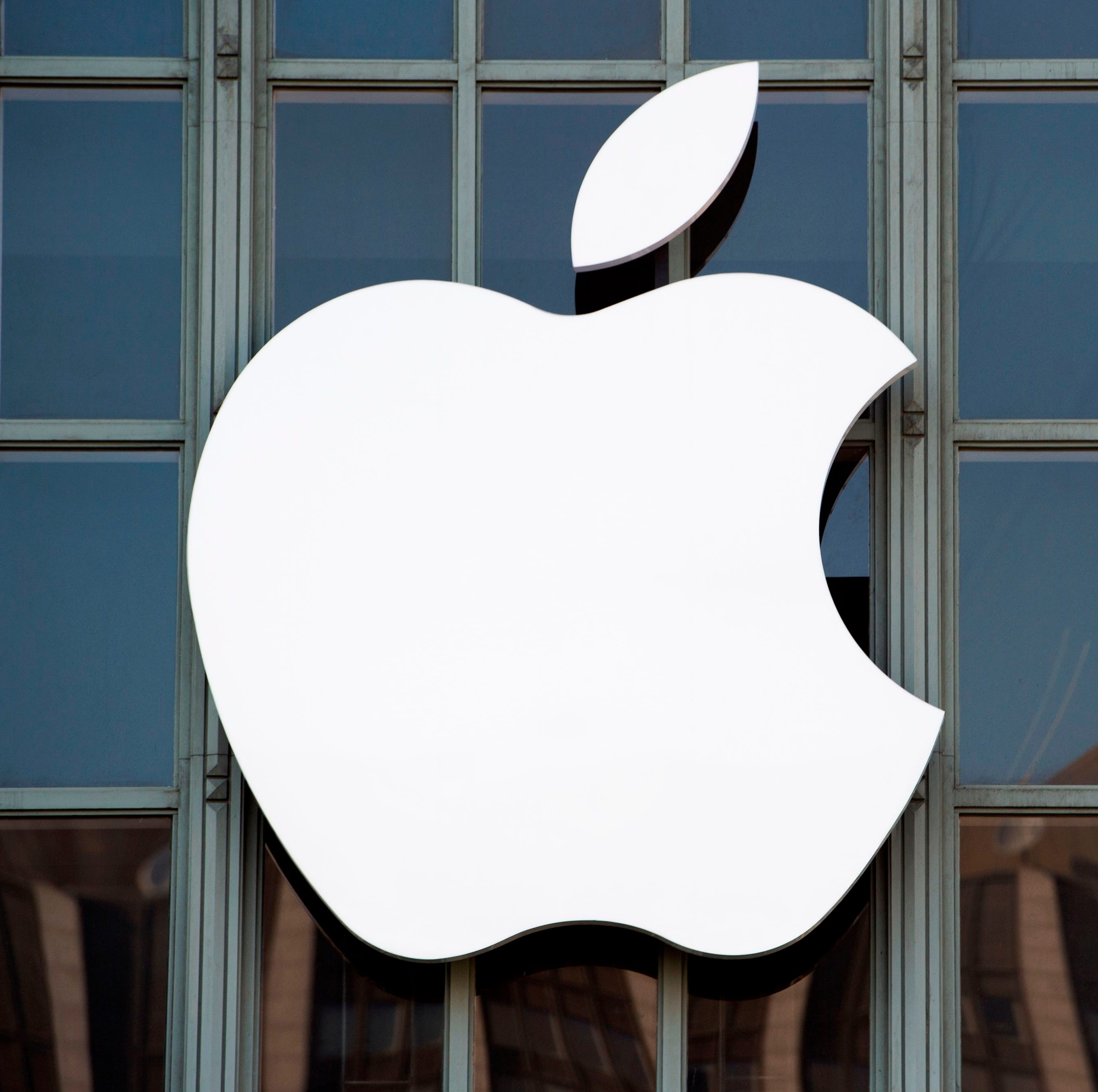 In this file photo taken on September 7, 2016 The Apple logo is seen on the outside of Bill Graham Civic Auditorium before the start of an event in San Francisco, California.