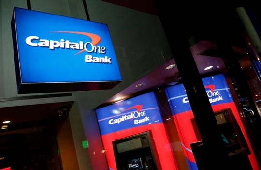 FILE - This Nov. 23, 2015, file photo shows a Capital One bank in New York. Capital One Financial Corp. reports earnings Tuesday, April 24, 2018. (AP Photo/Mark Lennihan, File) ORG XMIT: NYBZ257