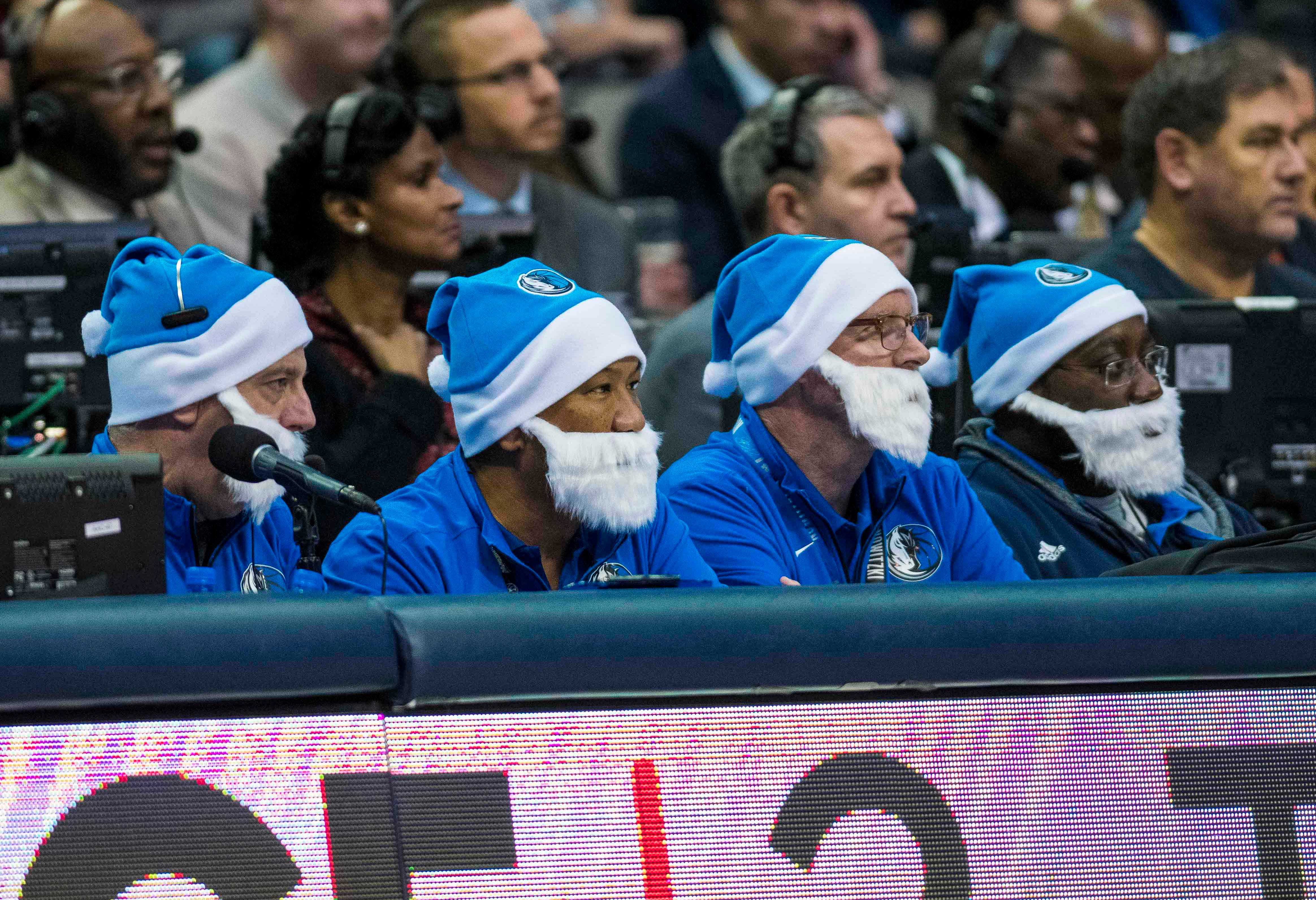 Dec. 12: Staff at the scorers' table sport some festive Mavericks-themed hats and beards.