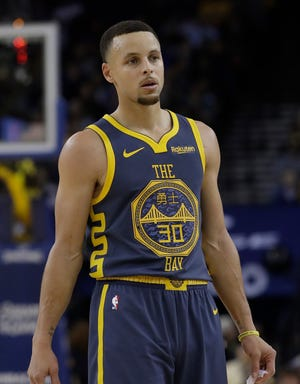 Golden State Warriors guard Stephen Curry (30) during the second half of an NBA basketball game against the Toronto Raptors in Oakland, Calif.
