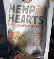 """A packet of """"Hemp Hearts"""" hemp seeds sits on a table at a Denver on Thursday, Dec. 13, 2018, during a news conference called to encourage President Donald Trump to sign the Farm Bill and expand hemp farming across the country."""