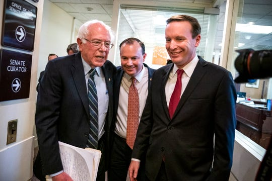 Independent Senator from Vermont Bernie Sanders (L), Republican Senator from Utah Mike Lee (C), and Democratic Senator from Connecticut Chris Murphy (R) leave a press conference after the Senate voted to end US military support for the Saudi-led war in Yemen, in the US Capitol in Washington, DC, on  Dec. 13, 2018. It is the first time the US Senate has invoke the War Powers Act to end American involvement in a war.