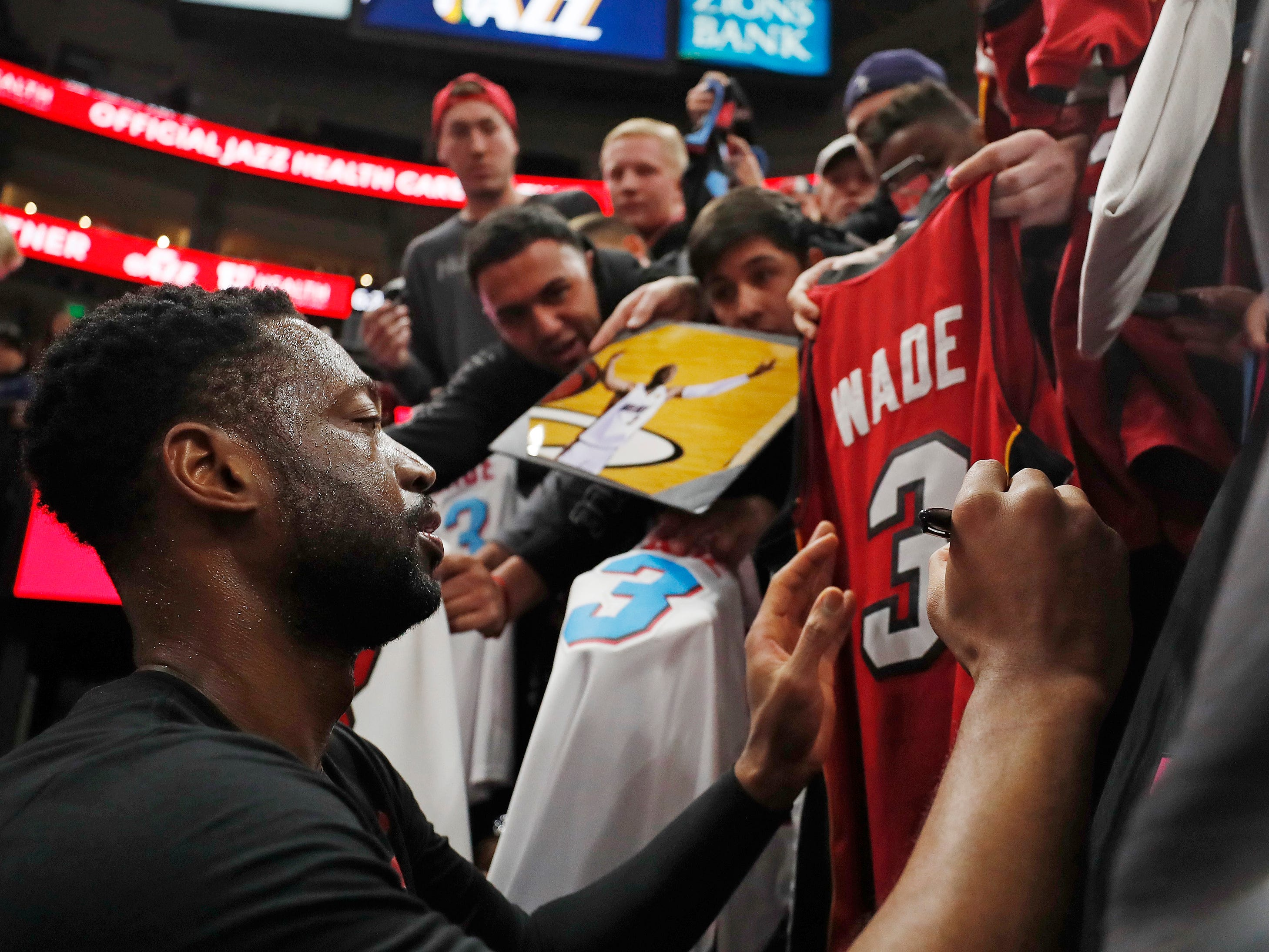 Dec. 12: Heat guard Dwyane Wade signs autographs before playing the Jazz in Salt Lake City.