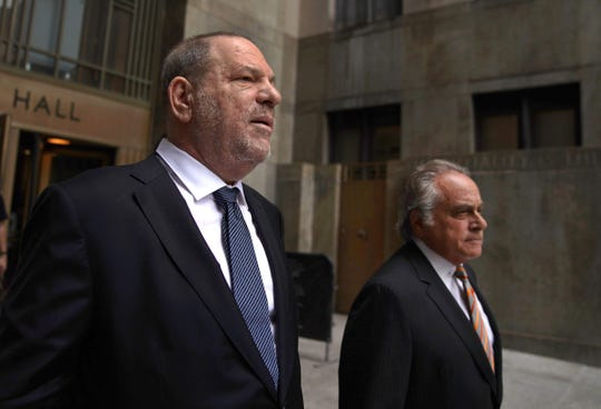 Accused sexual predator, fallen movie mogul Harvey Weinstein, and his defense lawyer Benjamin Brafman on Oct. 22, 2019, leaving court in New York.