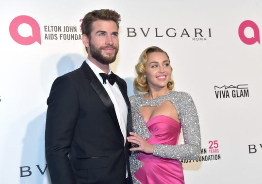 Liam Hemsworth and Miley Cyrus attend the 26th annual Elton John AIDS Foundation's Academy Awards Viewing Party on March 4, 2018.