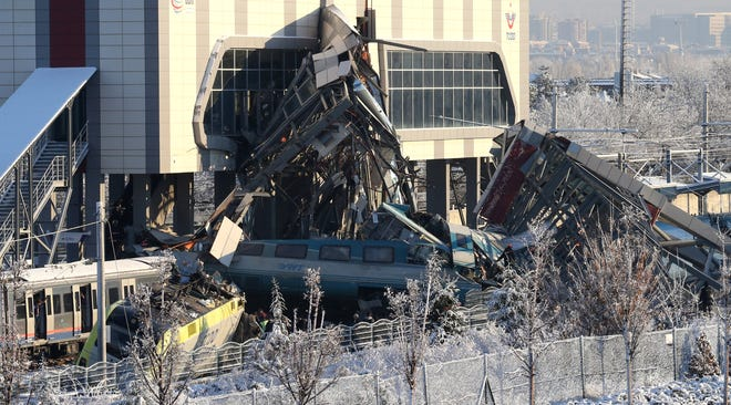 Firefighters try to rescue victims after a high speed train accident Thursday morning in Ankara, Turkey.