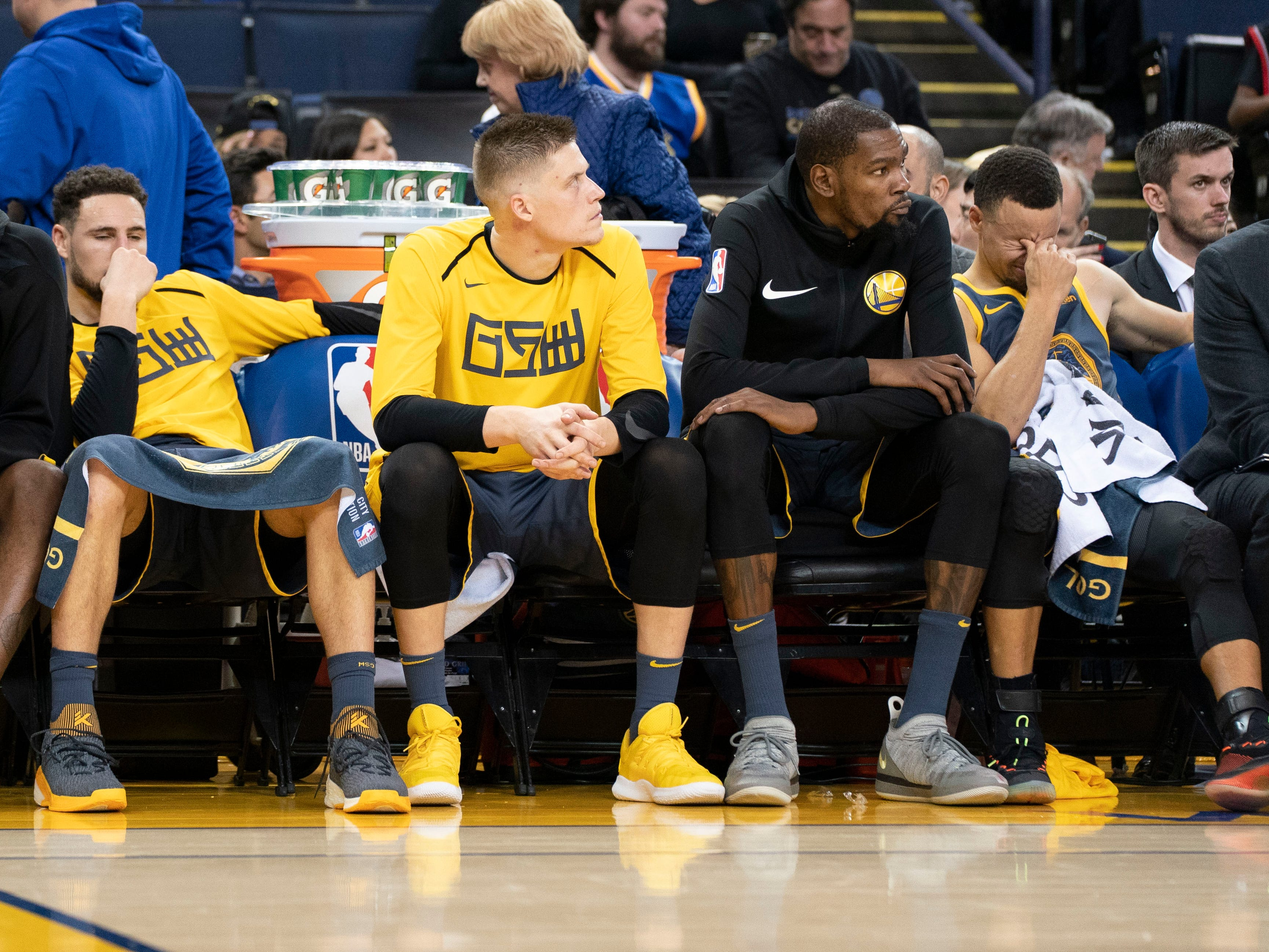 Dec. 12: From left, Klay Thompson, Jonas Jerebko, Kevin Durant and Steph Curry dejectedly look on from the Warriors bench during the closing minutes of a blowout loss to the Raptors in Oakland.