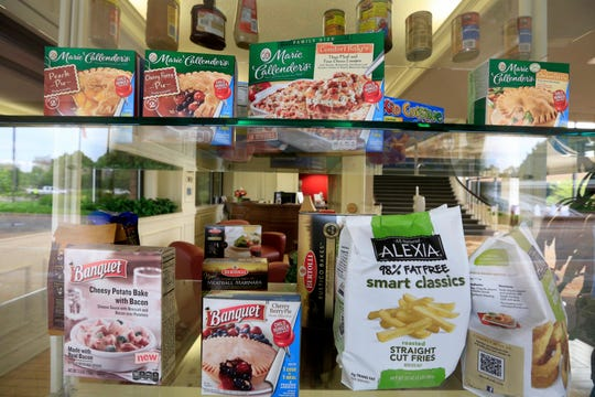 FILE - In this Tuesday, June 30, 2015, file photo, a selection of products made by ConAgra Foods is on display, in Omaha, Neb. ConAgra Foods Inc. reports financial results Thursday, Sept. 29, 2016. (AP Photo/Nati Harnik, File) ORG XMIT: NYBZ402 [Via MerlinFTP Drop]
