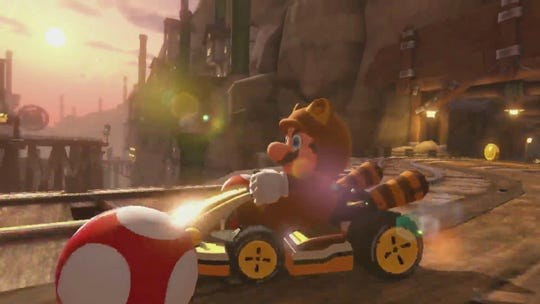 "Red clad, Mustachio-ed plumber Mario drives on a course in ""Mario Kart 8 Deluxe."""