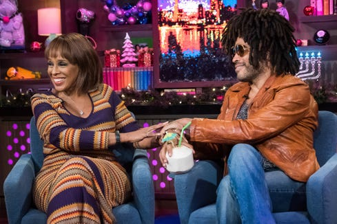 Gayle King holds hands with Lenny Kravitz