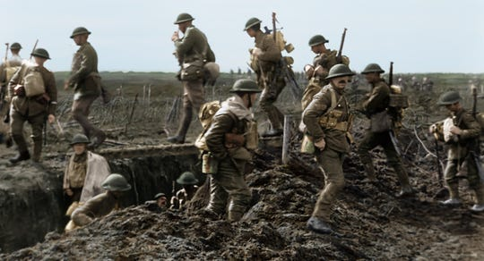 "British troops in the trenches in the World War I documentary ""They Shall Never Grow Old."""