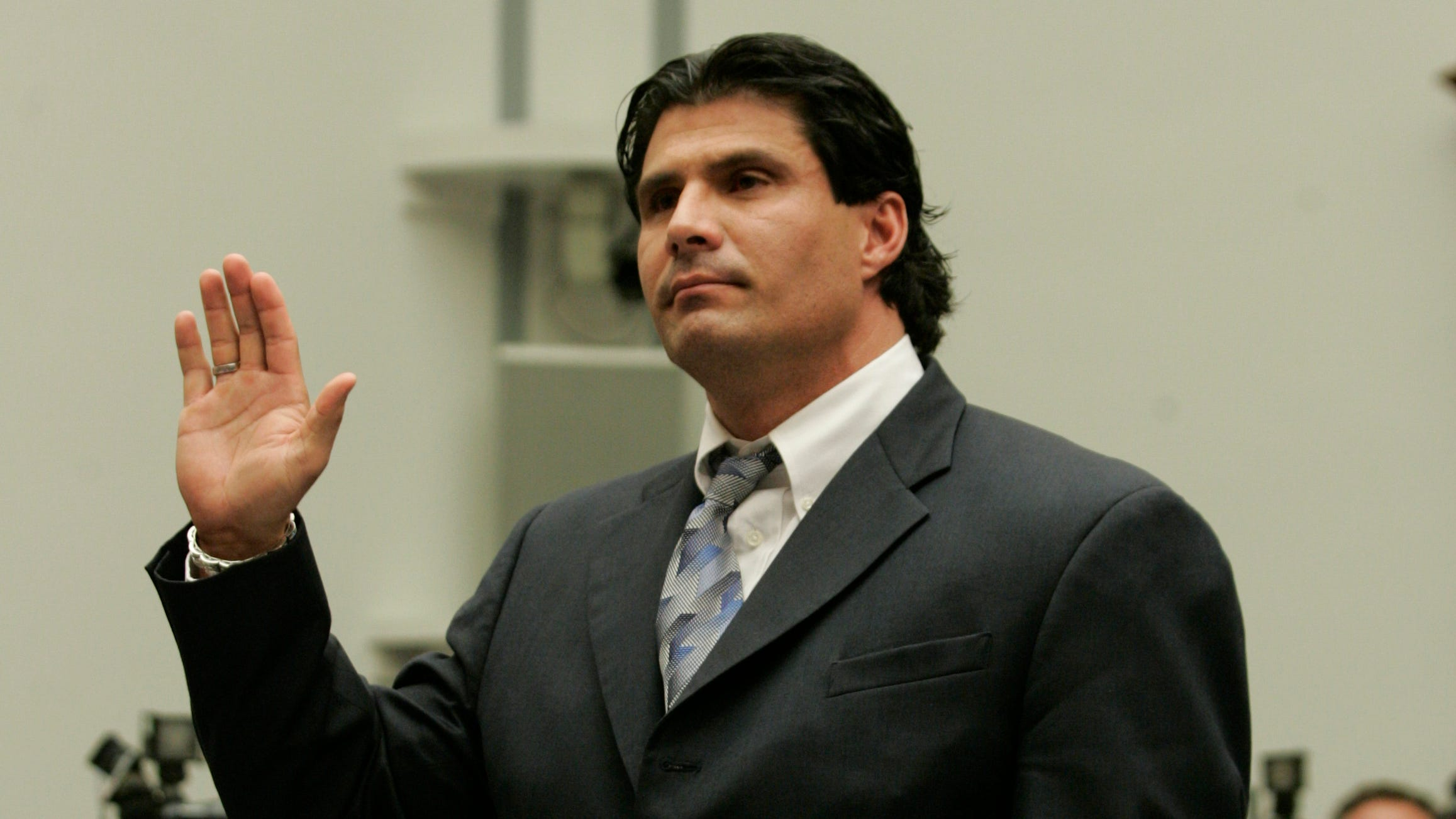 Jose Canseco is sworn in before he testifies before Congress during a 2005 hearing on steroid use in Major League Baseball.