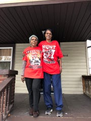 Dixie Hunt Dorsey (left), great-grandmother of Kareem Hunt, and Ava Hunt, his great aunt, show their support for the former Kansas City Chiefs running back. Dorsey and Hunt posed in front of their home in Cleveland.