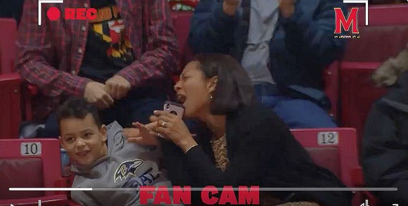 """Fans loved this mom embarrassing her son on the """"Fan Cam"""" while singing Kelly Clarkson's """"Since U Been Gone."""""""