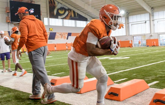 Clemson running back Darien Rencher (21) runs a drill with two footballs during practice for the Cotton Bowl at the Poe Indoor Facility in Clemson Friday, December 14, 2018.
