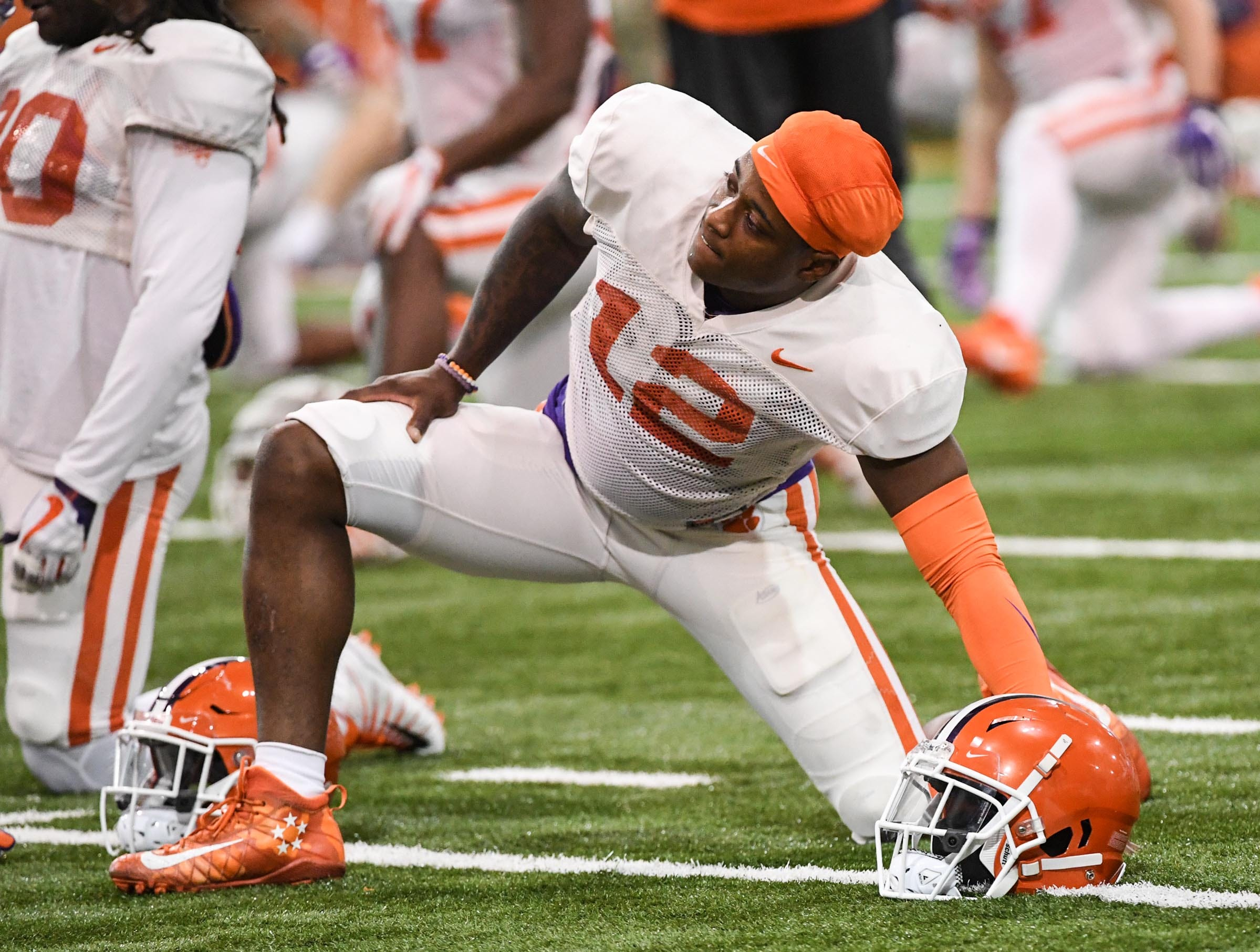 Clemson defensive back K'Von Wallace (12) stretches during practice for the Cotton Bowl at the Poe Indoor Facility in Clemson Friday, December 14, 2018.