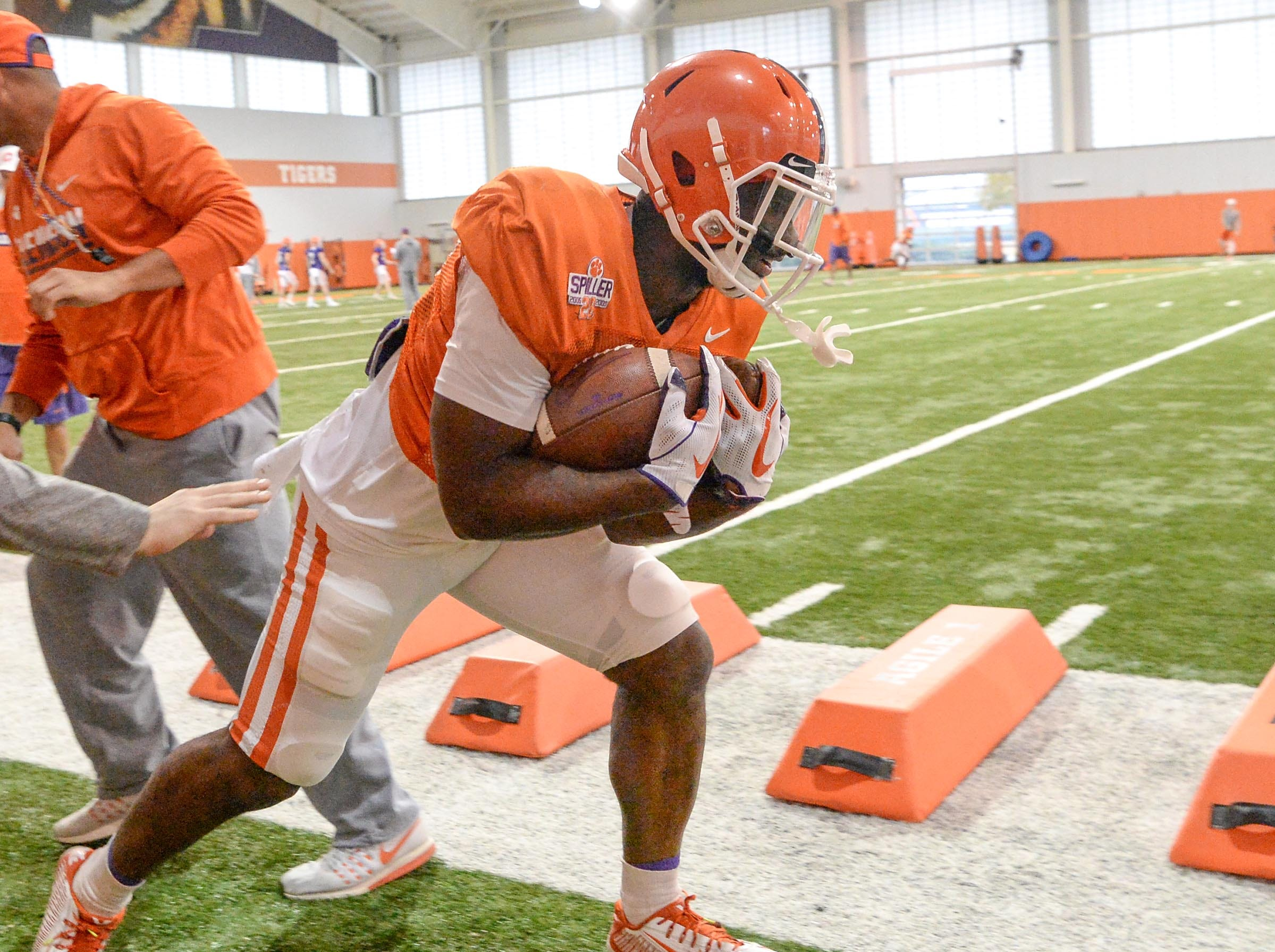 Clemson running back Tavien Feaster (28) runs a drill with two footballs during practice for the Cotton Bowl at the Poe Indoor Facility in Clemson Friday, December 14, 2018.