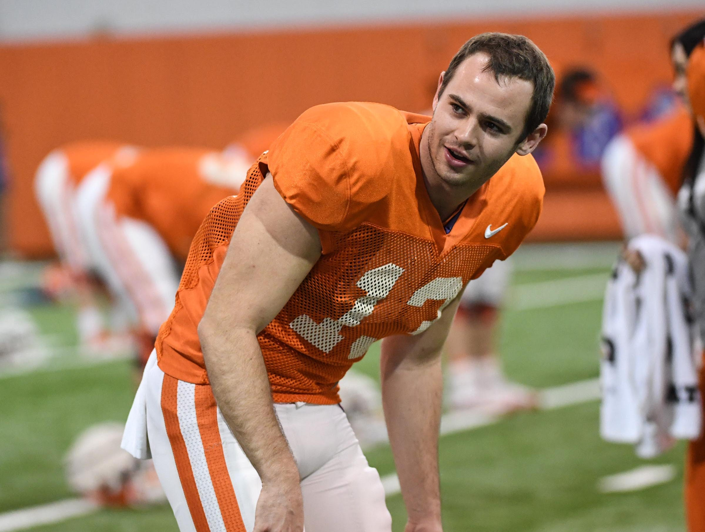 Clemson wide receiver Hunter Renfrow (13) stretches during practice for the Cotton Bowl at the Poe Indoor Facility in Clemson Friday, December 14, 2018.