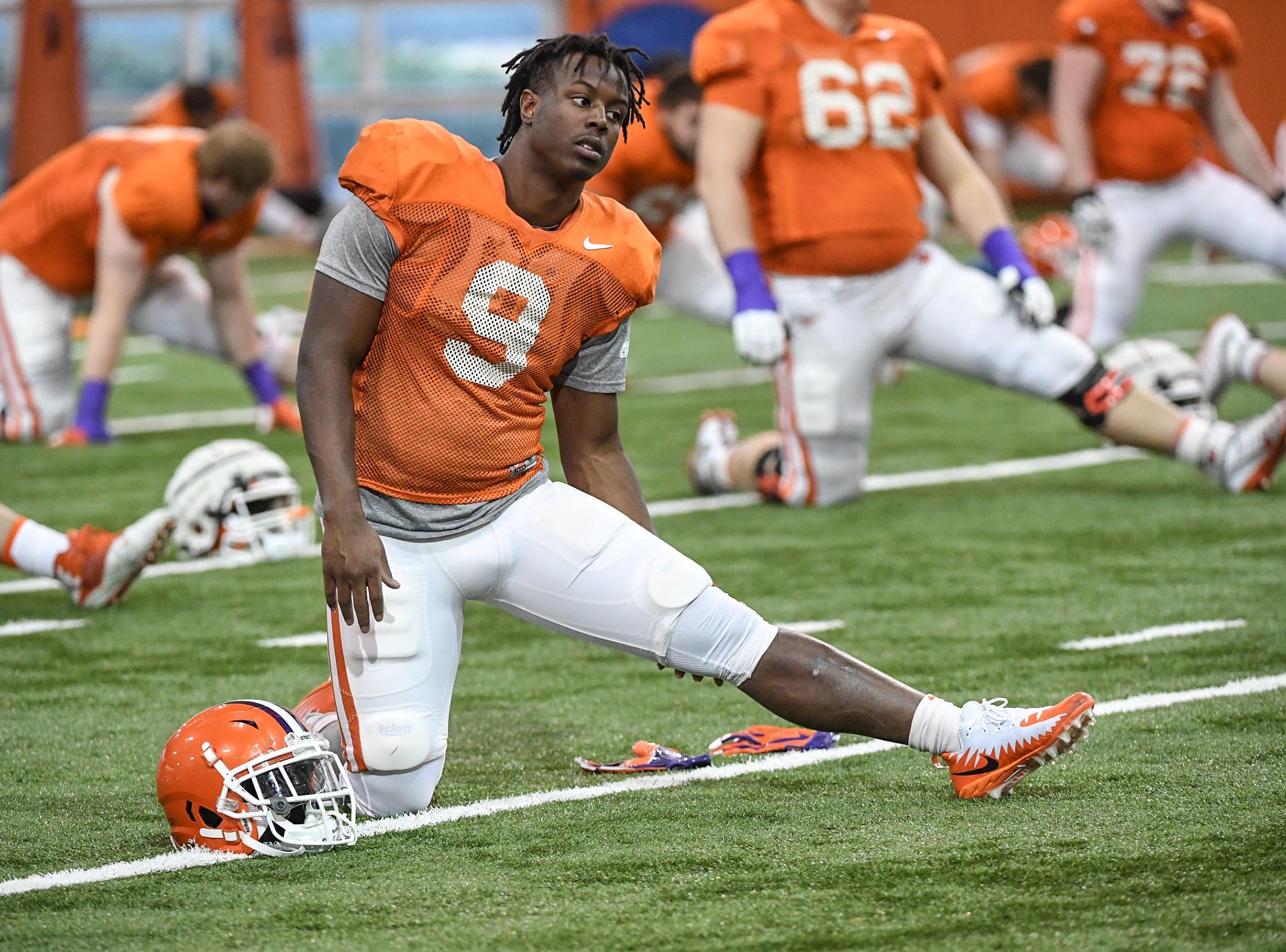Clemson running back Travis Etienne (9) stretches during practice for the Cotton Bowl at the Poe Indoor Facility in Clemson Friday, December 14, 2018.