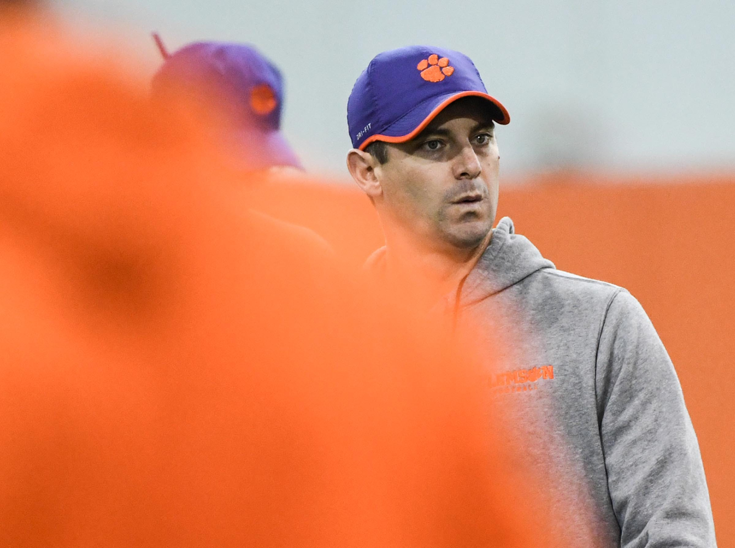 Clemson co-offensive coordinator Jeff Scott watches players stretch during practice before the Cotton Bowl at the Poe Indoor Facility in Clemson Friday, December 14, 2018.