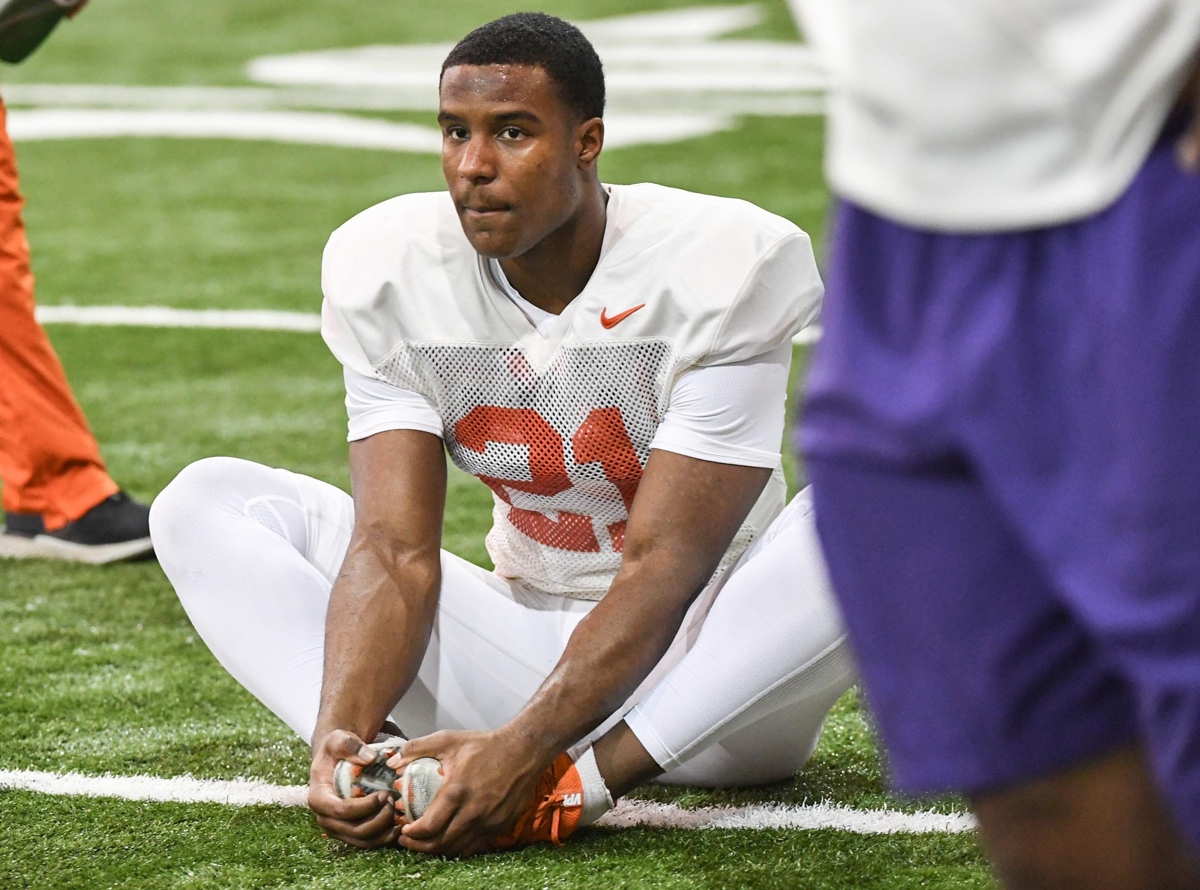 Clemson defensive back Kyler McMichael (21) stretches during practice for the Cotton Bowl at the Poe Indoor Facility in Clemson Friday, December 14, 2018.
