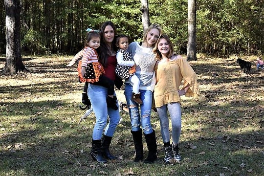 Brittney Metrehean (second from left) with daughters (from left) Baylianna, Brynnlea, Jayden and Julianna.