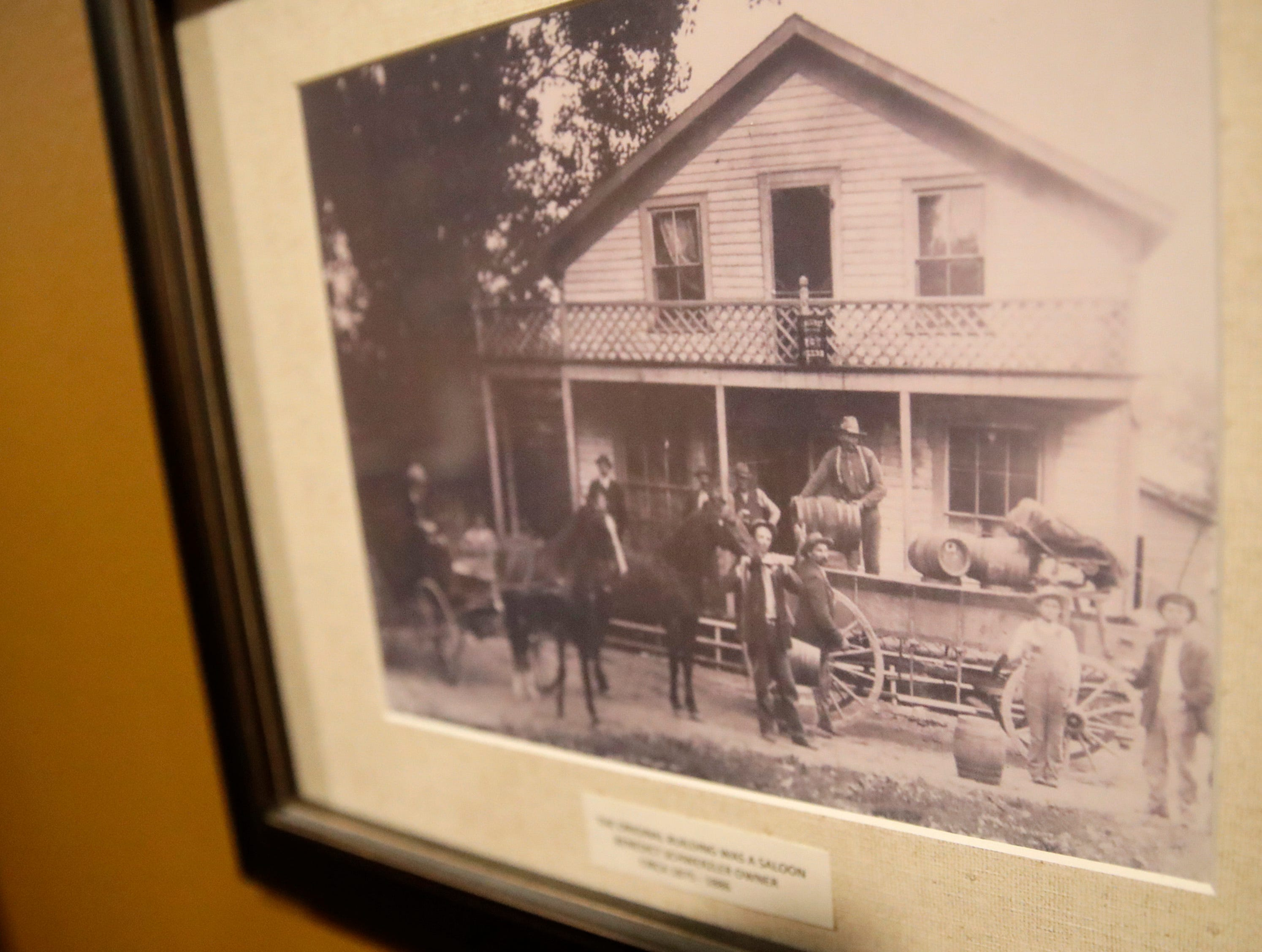 A framed photo of the original building that is part of Roepke's Village Inn circa 1875-1886 Wednesday, Dec. 12, 2018, in Charlesburg, Wis. The original building stands where Roepke's salad bar is now.
