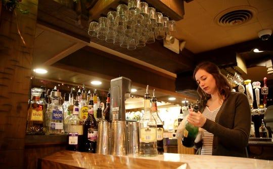 Seneca Stier, an employee with Roepke's Village Inn, cleans bottles Dec. 12 in Charlesburg.
