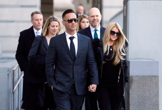 Mike 'The Situation' Sorrentino and Lauren Pesce leave the US Federal Courthouse in Newark on January 19, 2018.