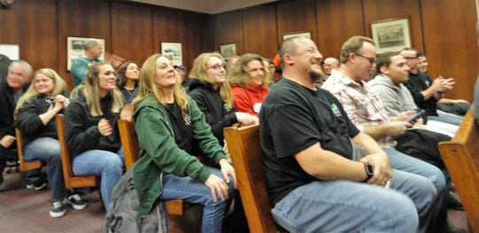 The announcement at Caffrey's restaurant will be allowed to rebuild receives cheers and applause at the Dec. 12 Planning Board meeting in Lacey.
