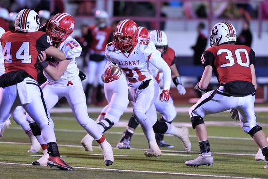 The loss of Albany running back/linebacker Cutter Edgar (21) to injury left holes on both sides of the ball Thursday against Gruver.