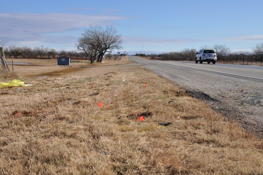 Orange flags mark where a fatal three-vehicle crash occurred Thursday on U.S. Highway 83 about one mile north of Tuscola. Mayor Robert Elkins and his wife, Vondean, were killed in the collision.