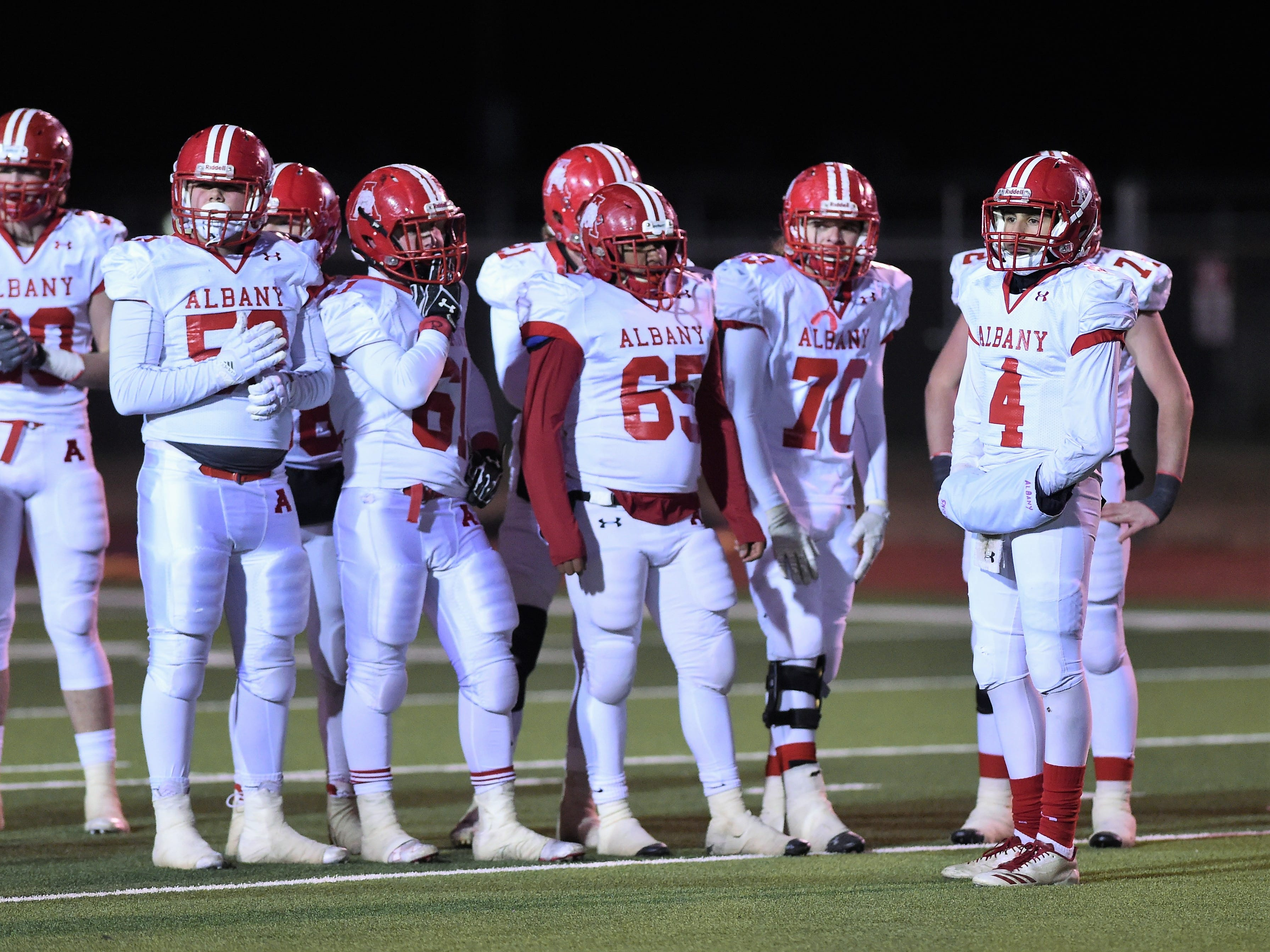 The Albany offense looks to the sideline for a play call against Gruver in the Class 2A Division II state semifinal at Sherwood Memorial Bulldog Stadium in Plainview on Thursday, Dec. 13, 2018.