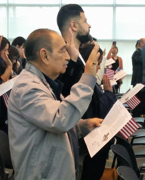 Bert de la Vega takes the oath to become an American citizen.