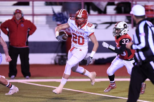 Albany's Ryan Hill (20) returns an interception for a touchdown against Gruver in the Class 2A Division II state semifinal at Sherwood Memorial Bulldog Stadium in Plainview on Thursday, Dec. 13, 2018.