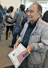 Bert de la Vega is all smiles after becoming an American citizen Nov. 30 in Irving.
