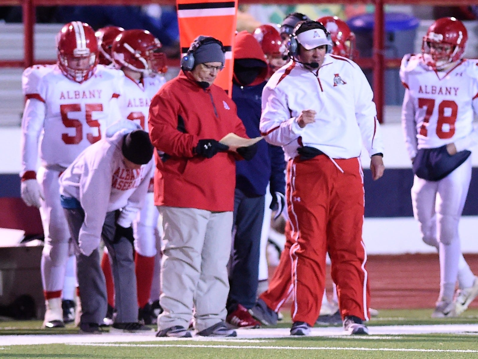 Albany head coach Denney Faith looks at his play sheet against Gruver in the Class 2A Division II state semifinal at Sherwood Memorial Bulldog Stadium in Plainview on Thursday, Dec. 13, 2018.