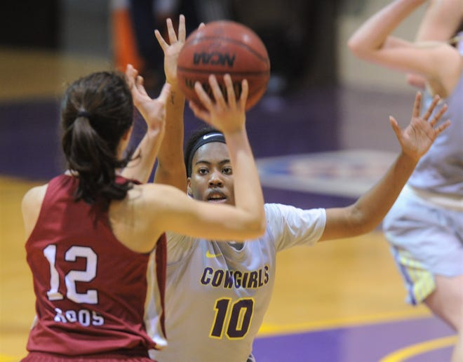 Hardin-Simmons' Taylor Gaffney (10) defends against Austin College's Caitlyn Collins (12) during the second half of their nonconference game Thursday at the Mabee Complex. Austin College won the game 62-48.