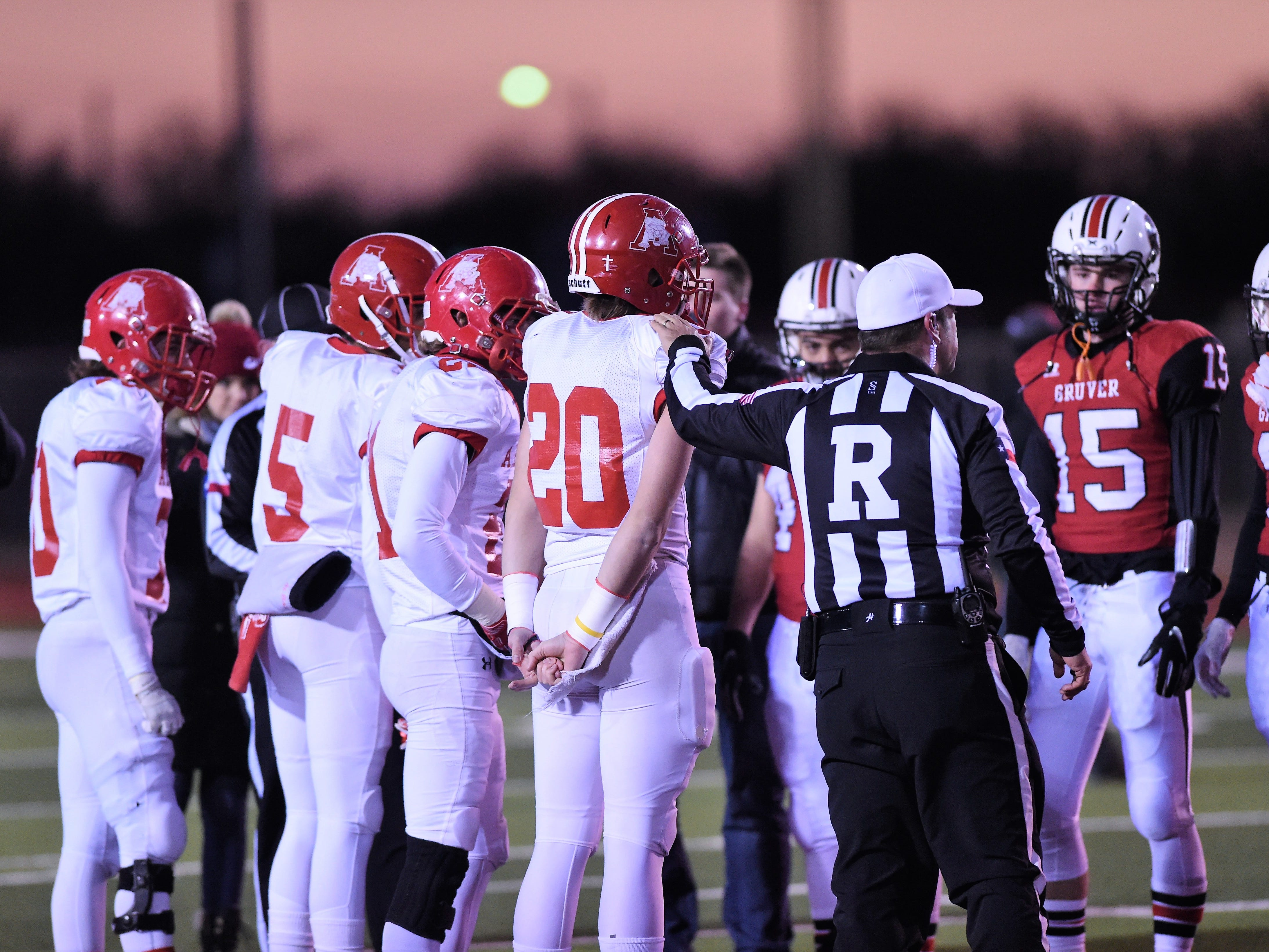 The referee indicates Albany won the coin toss against Gruver in the Class 2A Division II state semifinal at Sherwood Memorial Bulldog Stadium in Plainview on Thursday, Dec. 13, 2018.