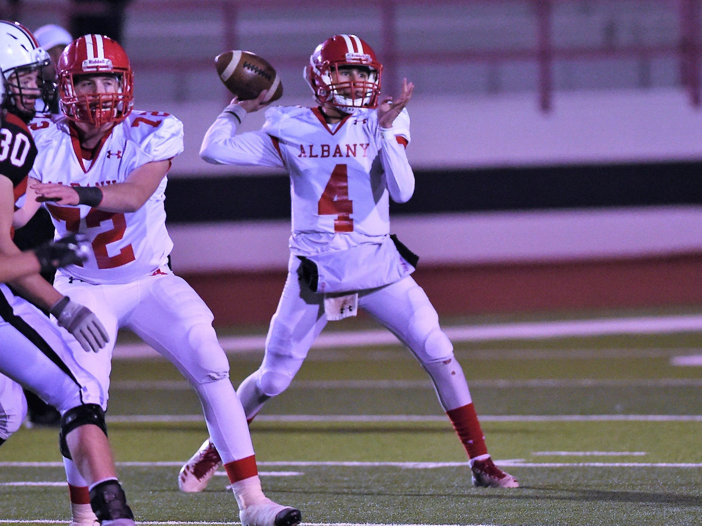 Albany quarterback Ben West (4) throws a pass against Gruver in the Class 2A Division II state semifinal at Sherwood Memorial Bulldog Stadium in Plainview on Thursday, Dec. 13, 2018.